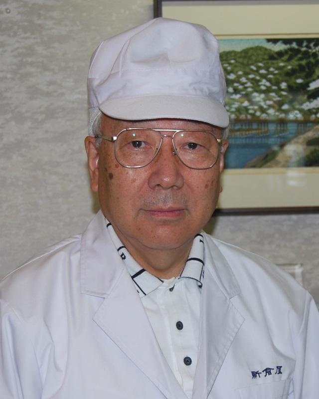 新倉 吉晴 氏